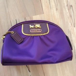 Coach purple satin cosmetic bag